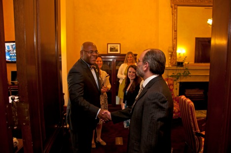 Josh Greenberg from Boston Children's office of Government Relations, shakes hands with Mass. Senator Mo Cowan.